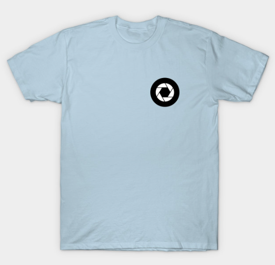The design on the front of the shirt is the tire/ camera aperture that is the wheel in our TLT logo.