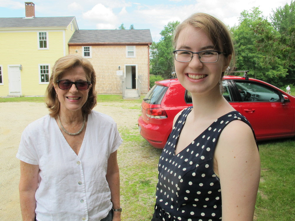 Jonathan Fisher house docent Judy and summer intern Samantha Curtis welcome those attending the symposium.