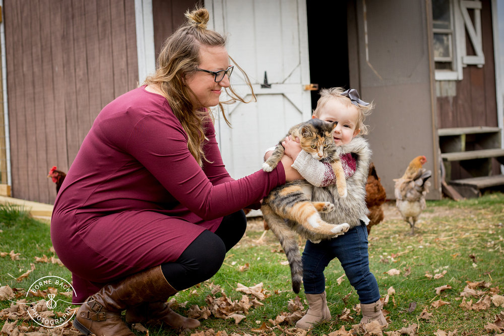 In between the family photos, Baby G just couldn't resist her kitten and chickens. I loved that not only could we get some fabulous family portraits, but we could also capture this girl's amazing heart for animals and the obvious nurturing of that love from her momma.