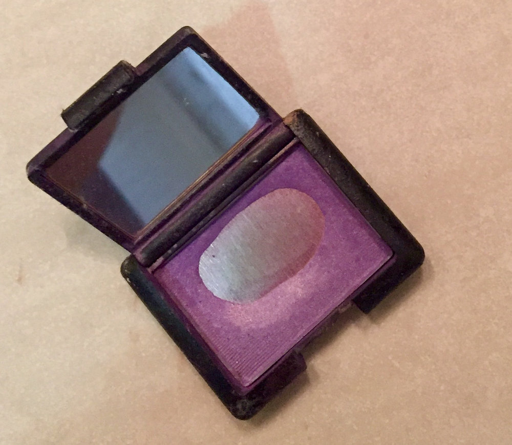 I can't recall where or when I bought this eyeshadow, but shortly after taking the picture, I threw it out.