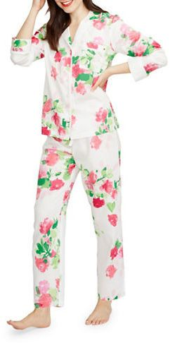 This Kate Spade sateen fabric pajama set is classically styled with a  long-sleeved button down top and pull on pants. The flower print is pretty  and fun 71b23fc94