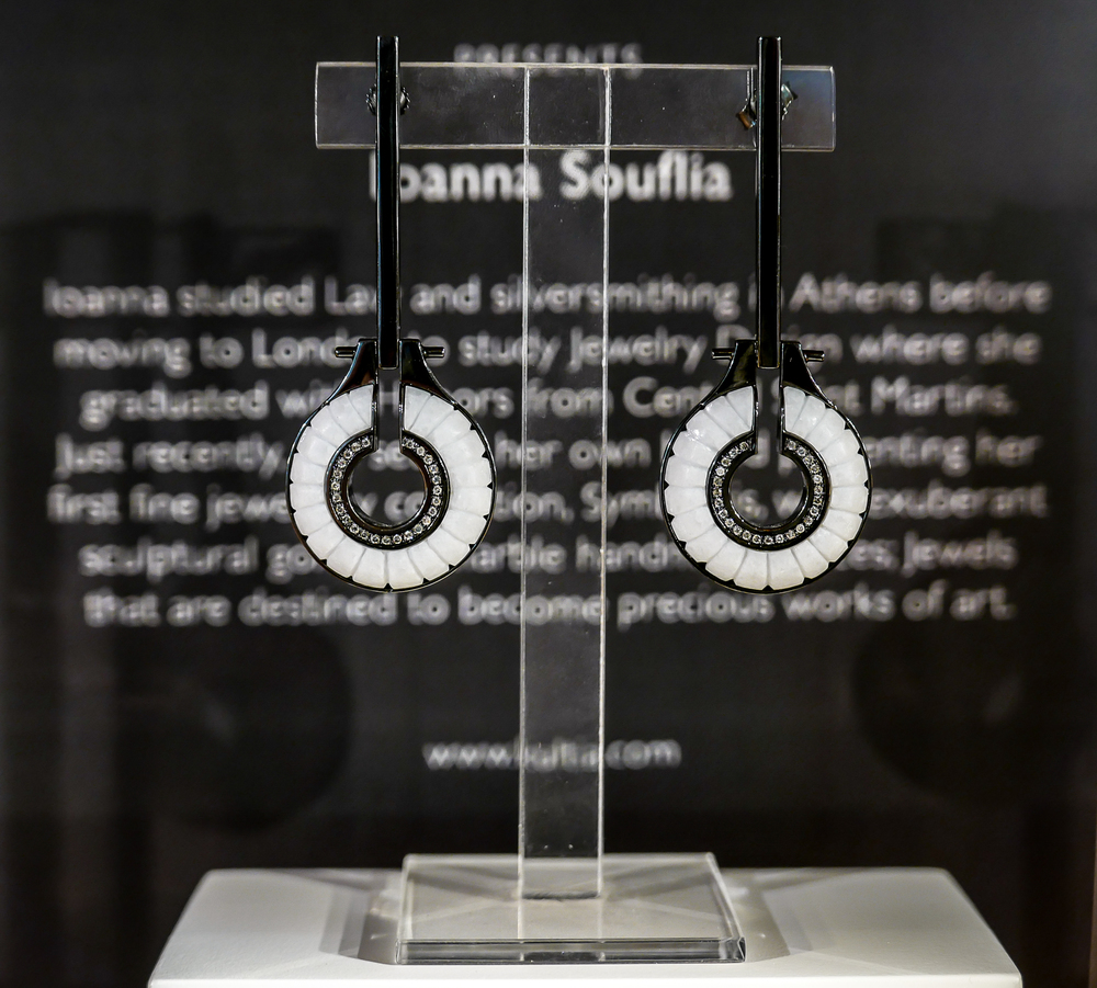 The Ioanna Souflia earrings are made from 14 carat black gold and white Thasos marble, with inlayed grey pave diamonds.