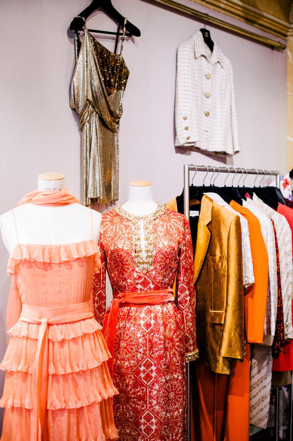 An assortment of designer dresses and jackets