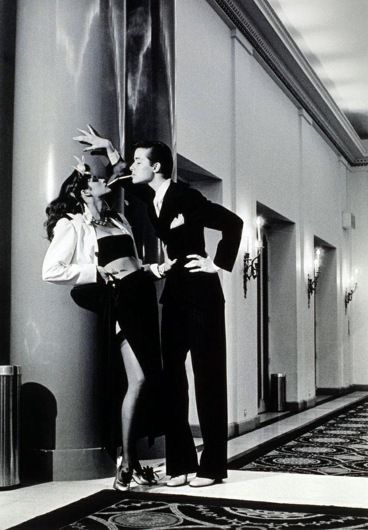 Helmut Newton,  Woman into Man, Lighting a Cigarette , Vogue, 1979