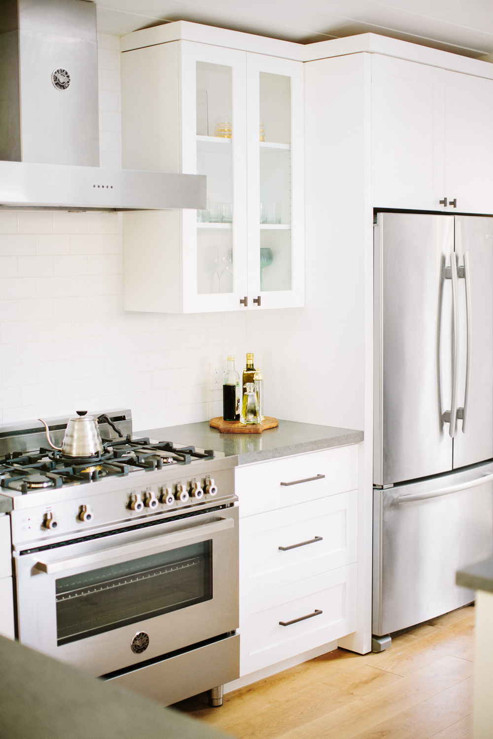 White modern kitchen design by Carly Waters Style
