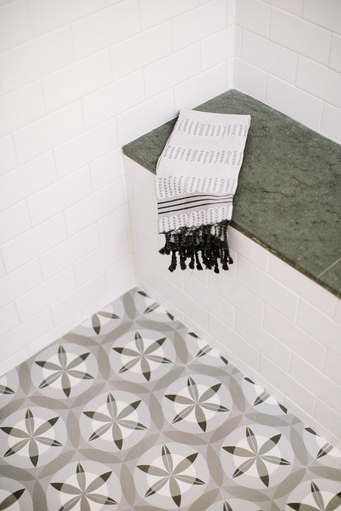 White, modern bathroom tile decor design by Carly Waters Style