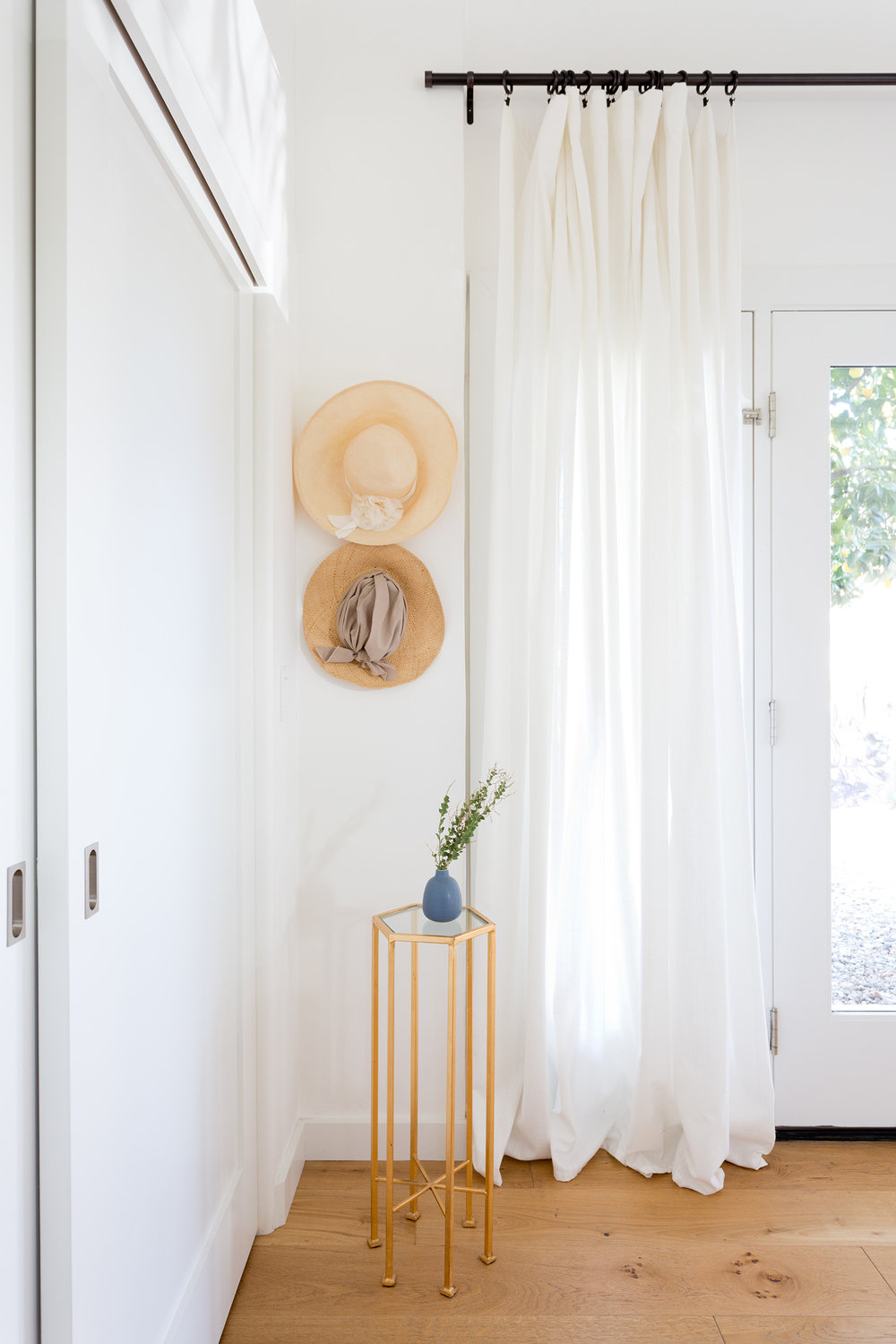 White and bright entry space design by Carly Waters Style