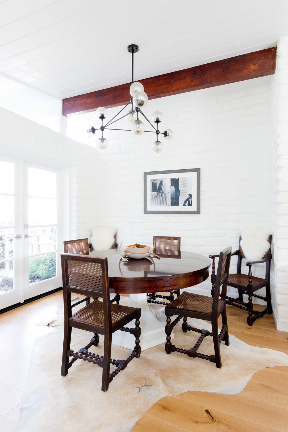 Modern wood dining room design by Carly Waters Style