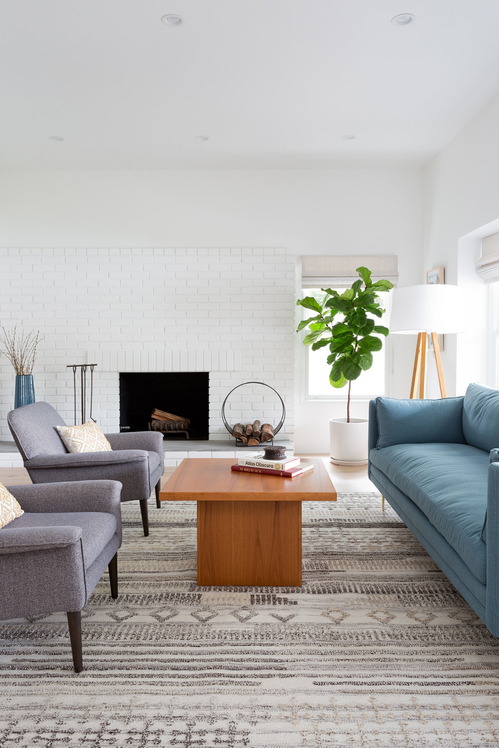 Bright & warm living room designed by Carly Waters Style