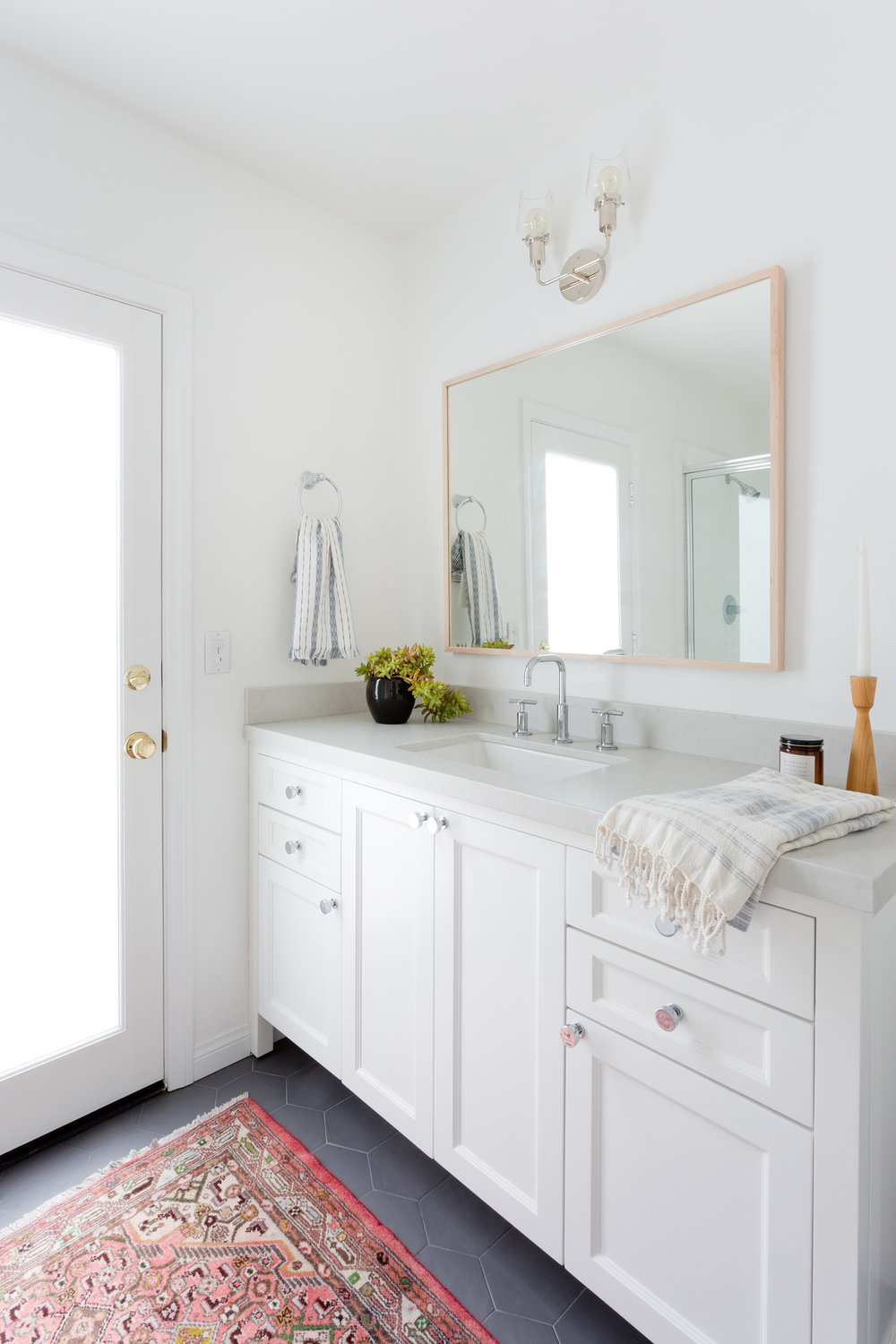 White and bright modern bathroom design by Carly Waters Style