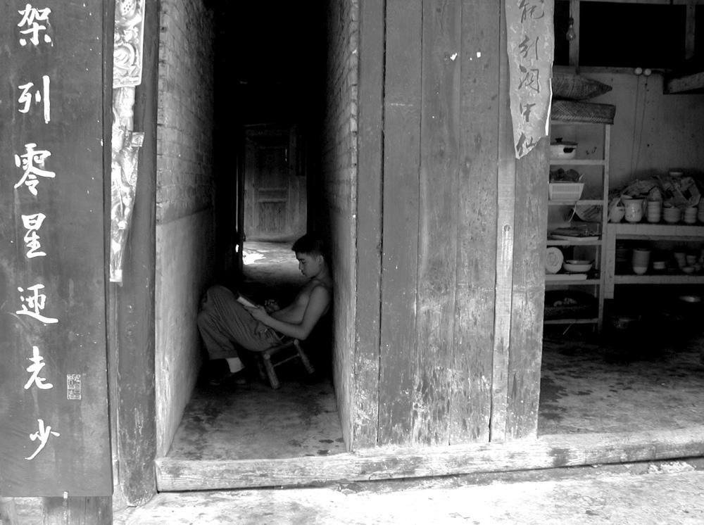 china boy in doorway.jpg
