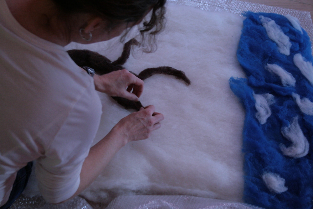 -Theresa Flaherty working on her wet felted tree wall hanging