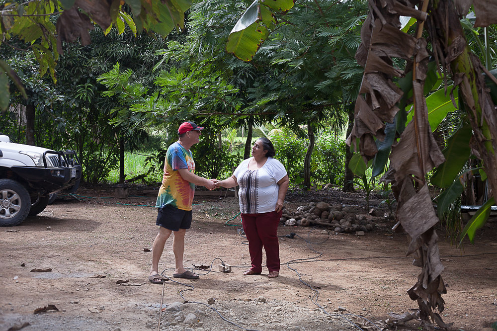 Madam Lucy - Here is Jay shaking hands with Madam Lucy. Her energy was one of gentle sweetness.  She is a pastor of her community and on their land among banana, papaya and yucca trees there is an open air chapel with benches and an altar.   On Sunday's she greets her community under the shade of the chapel's tin roof to praise God in his glory.  She is a mother who cares for her family and loves her community.