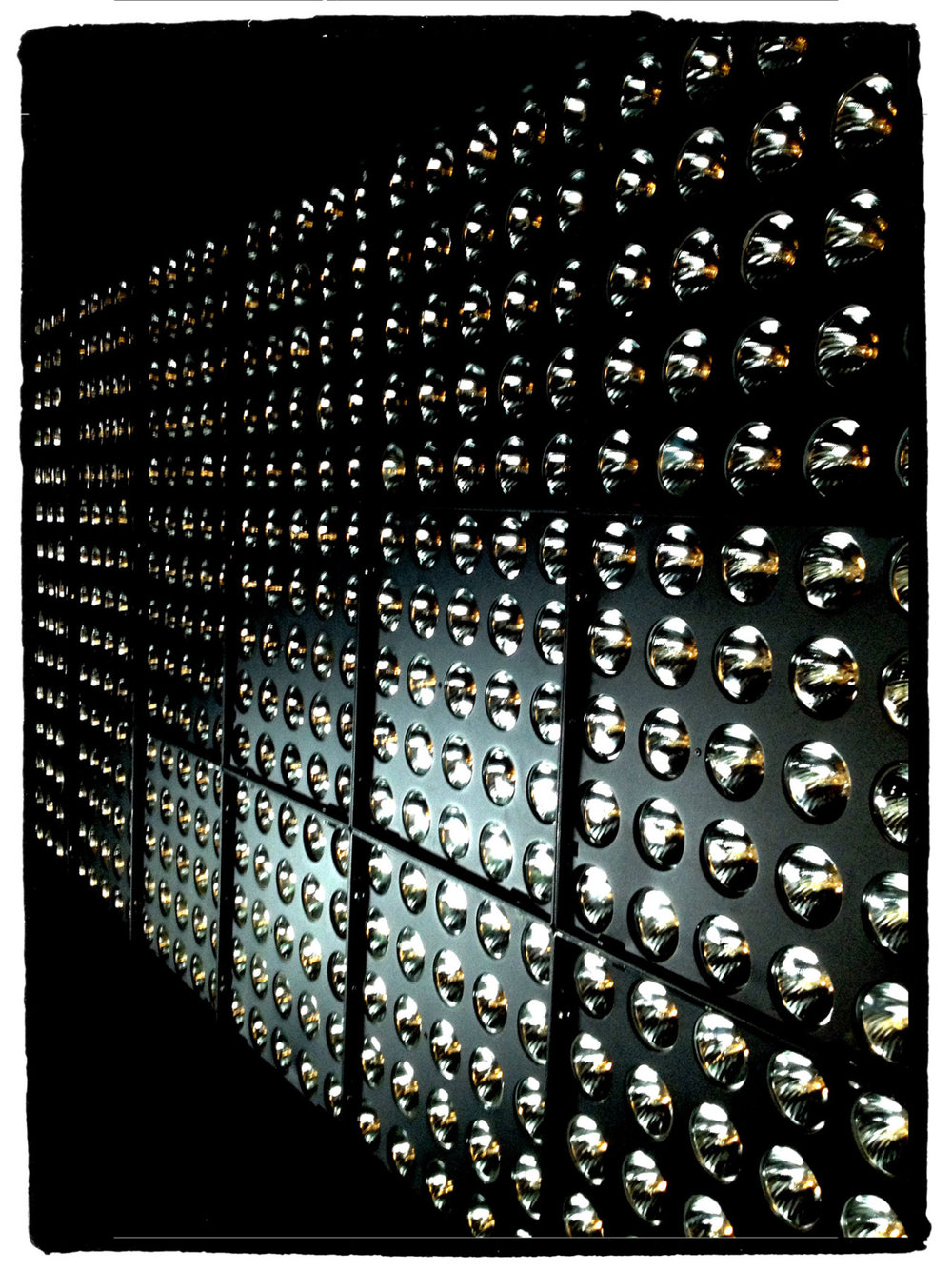 The Jarag by Chromlech- what a light!   This photo shows a wall of 21 individual units- each one is comprised of 25 x 75W par bulbs- a total of 1800 watts per unit, so in this case , 37,800 Watts.    I used this as a light source for one shot and I assure you it kicks out the lumens and heat!    This source is also very versatile- it is easily programmable and is very sensitive / responsive when creating effects sequences.   Examples from this job will follow a few months from now.   Here is a link for more info on the Jarag:     http://www.chromlech.fr/pages/en/products/jarag-5-range.php?lang=FR