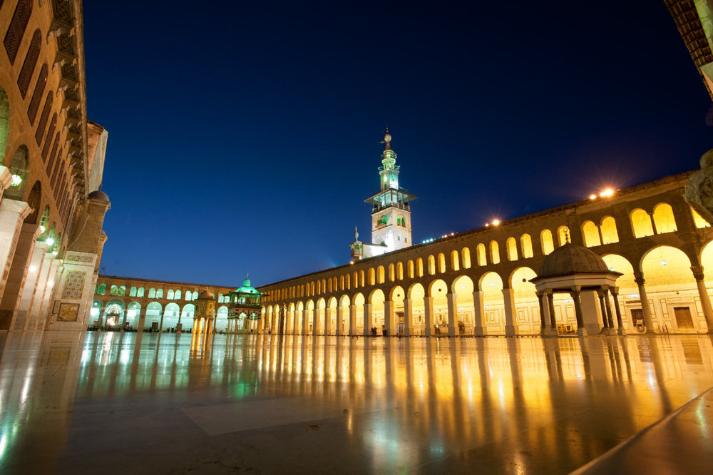 Ummayad Mosque, Damascus, Syria.   Shot I took from a trip to Syria in 2009. Lovely place, especially Damascus.   This shot is on a wide lens, waited for magic hour, and shot off a tripod with a long exposure and deep stop, Nikon D700.