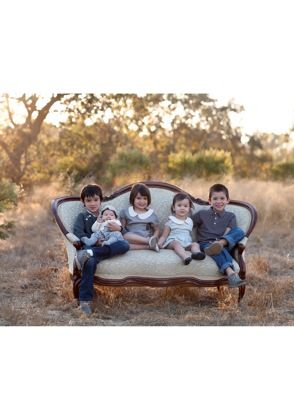 siblings portrait by vintage settee in walnut creek