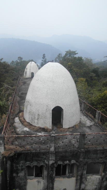 Ashram attended by the Beatles in 1968, now crumbling and overgrown by the forest.