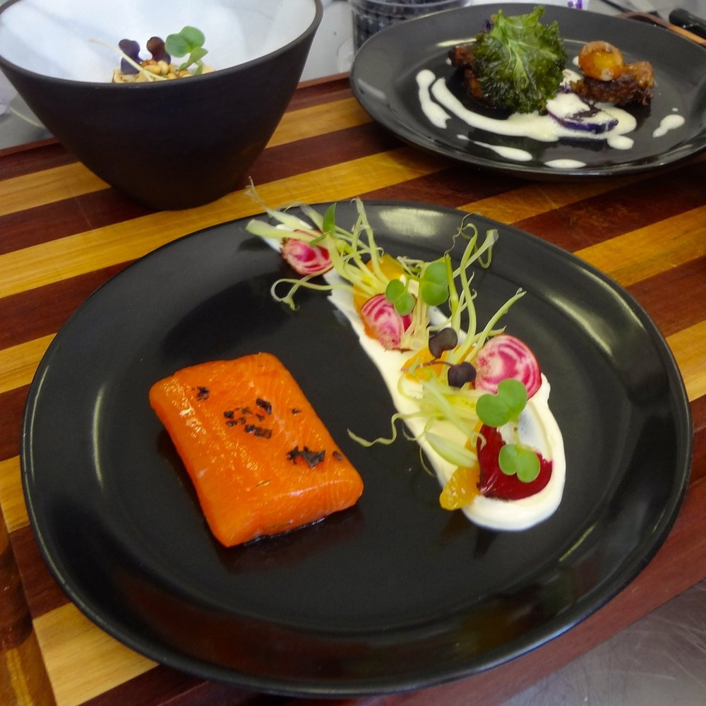 olive oil confit salmon trout with horseradish cultured cream rainbow beet fennel and black salt