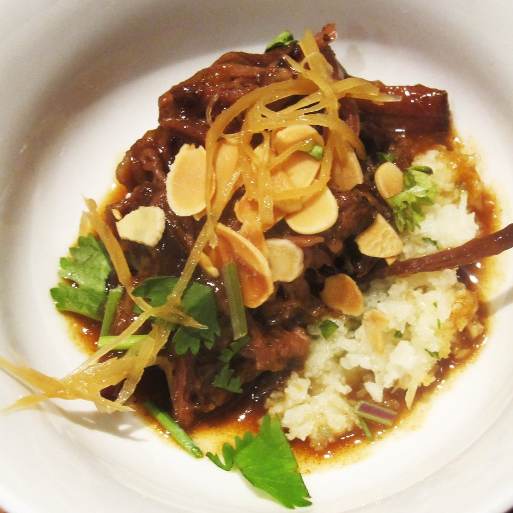 vietnamese braised short rib with confit ginger almonds and cauliflower rice