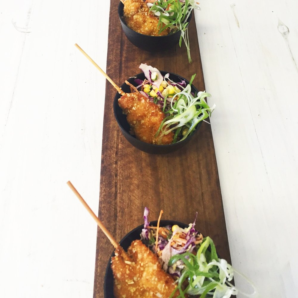 roasted rolled oats and almond crumbed free-range chicken strips with sweet corn and cabbage slaw