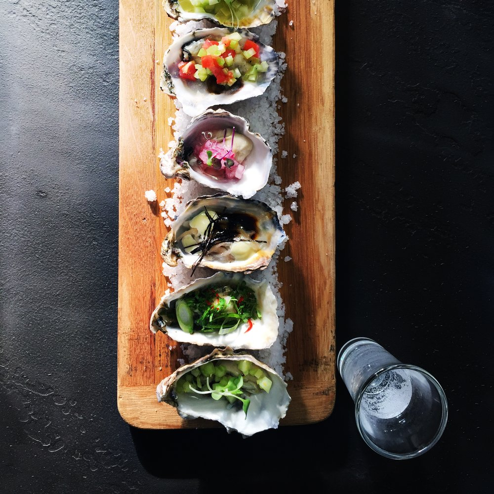 oysters with various toppings