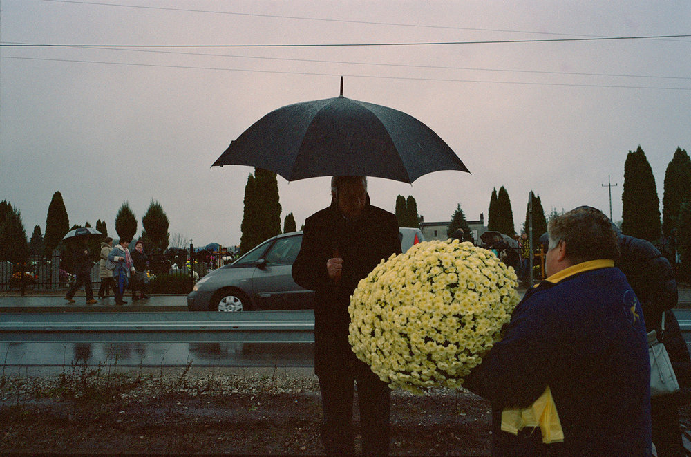 Dad buying chrysanhemums at the cemetery on All Saints' Day.jpg