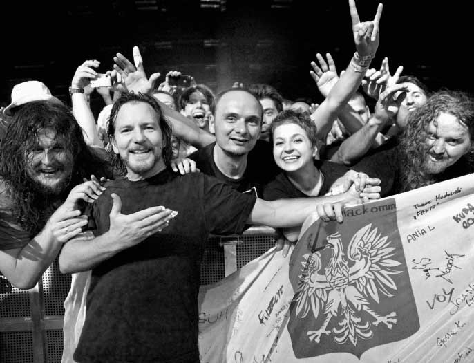 "Eddie Vedder and members of the Polish fan group ""Touring Poles."" Forum, Copenhagen. July 10, 2012. Page 215."
