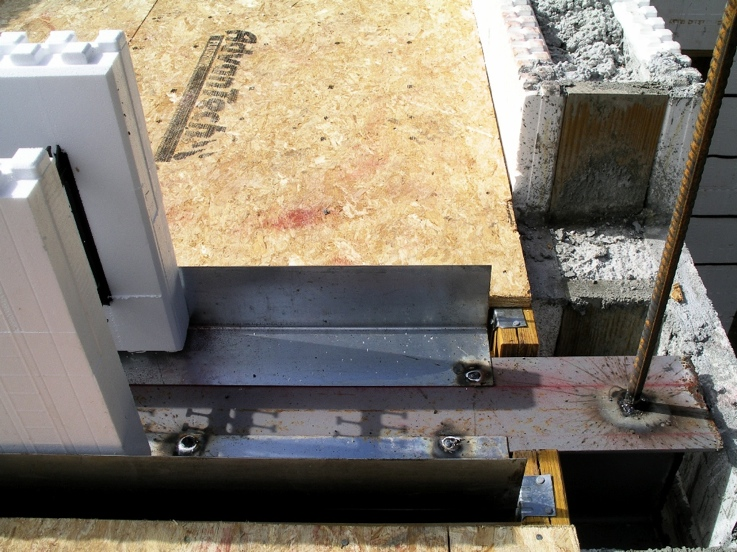Channels welded to top of steel beam to receive ICFs