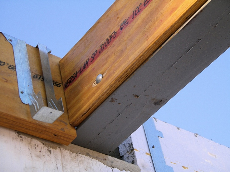 Floor joists incorporated into side of steel beam