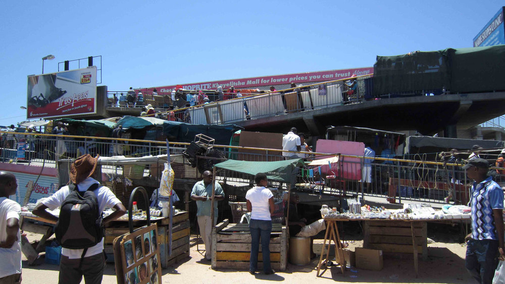 Khayelitsha, Cape Town. Stalls beside Khayelitsha Metrorail station. Photo by Stokperdjie
