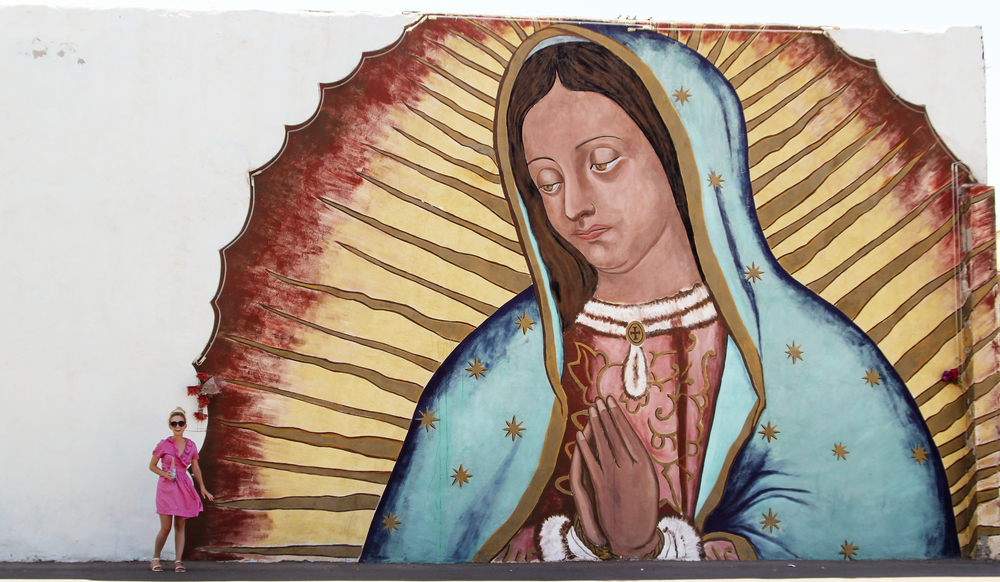 "Lovely dubbed ""Our Lady of the Pump"" because this gorgeous mural of Our Lady of Guadalupe stoically overlooks motorists as they filled their gas tanks."