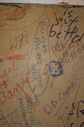 Bathroom wall at the         State Line Tavern