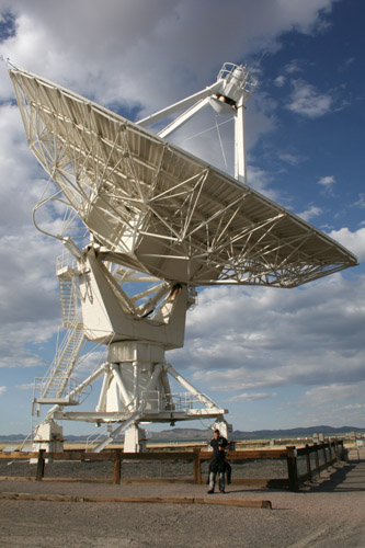 Tracy & one of the radio antennas at the VLA