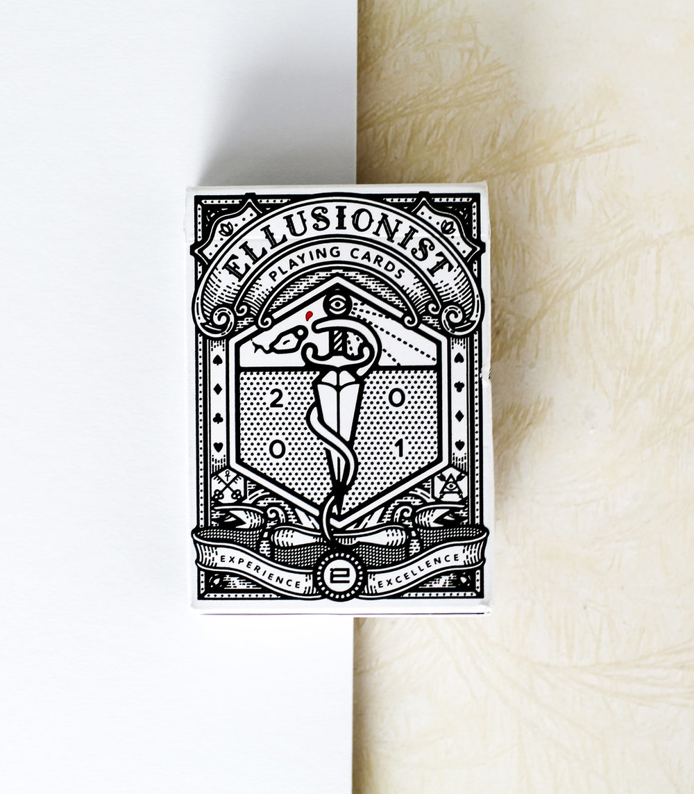 The Ellusionist Deck - The Ellusionist deck was designed as a celebration of the companies heritage, filled with easter eggs that refer back to past products and projects. Oban illustrated the packaging to have the feel of a classical sideshow attraction, whilst the clean, minimal style gives it a modern edge. Produced originally as a staff only deck for Ellusionist employees and for use in filming project and promos. It was later released to the public for a brief period and became one of Ellusionist's fastest selling decks.