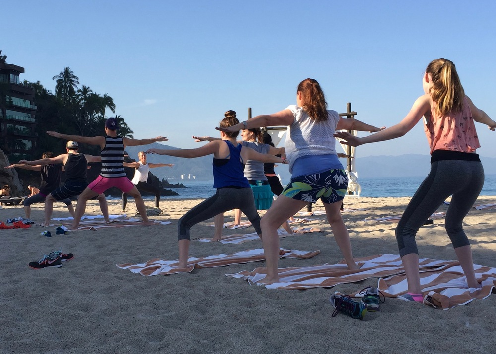 Start the day with yoga on the beach