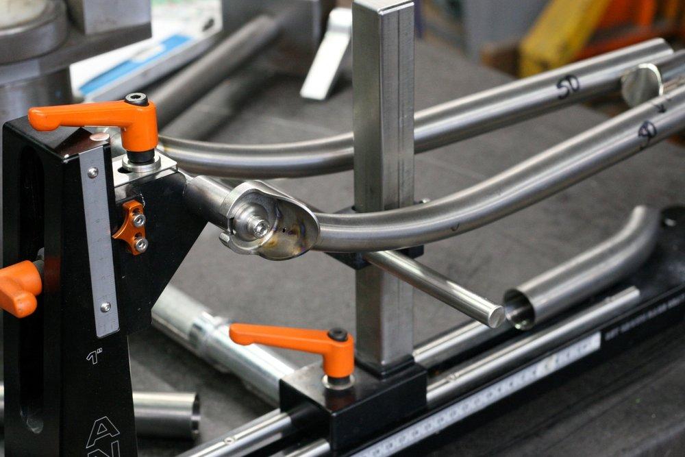 TCF-Shop-Framebuilding-Fork-in-Fixture-titanium (4).JPG