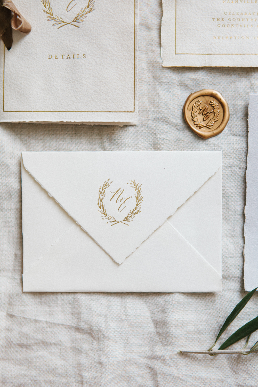 handmade paper gold foil invitations nashville wedding written