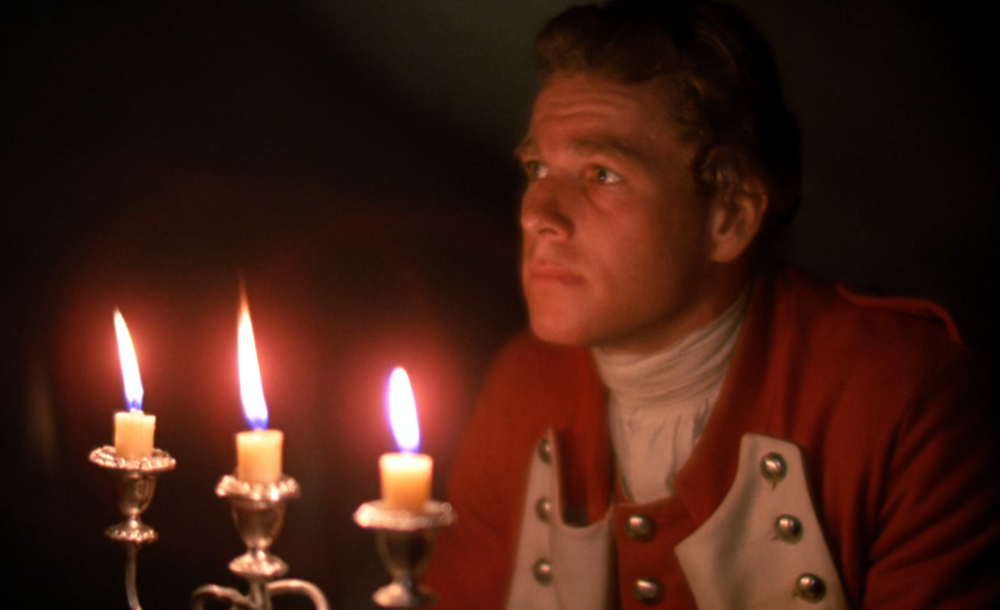 Still from Barry Lyndon, 1975 by Stanley Kubrick and John Alcott. Scenes such as this one, lit only by candle light this was shot on Kodak 100T 5254; an ASA 100 film that was only pushed to 200 ASA, for use with the Zeiss Planar 50mm ƒ/0.7 that he borrowed from NASA.