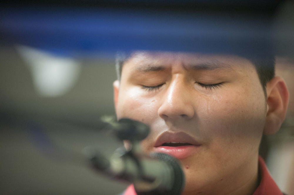 Marvin Velasco, 14, sings and plays the keyboard at San Juan 3:16 Church in Los Angeles, California. The parish became Marvin's safe haven after he made a solo journey of more than 2,000 miles from Guatemala to the US in 2014.    Image by Charlie Magovern @GlobalPost.com