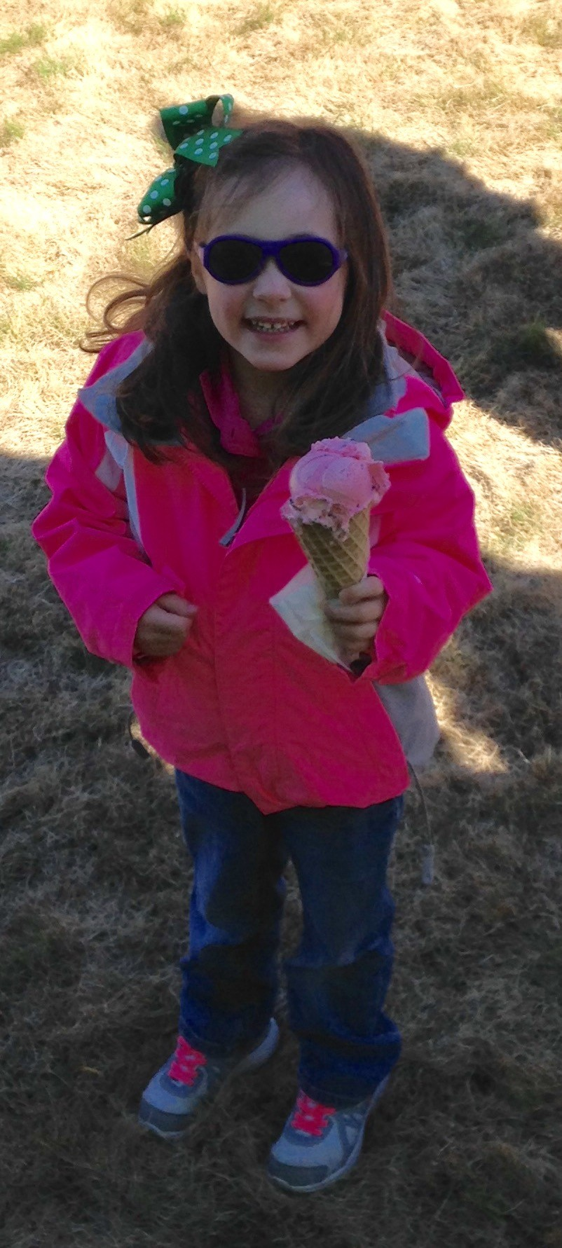 Little girl eating her ice cream cone