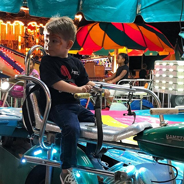 Little dude's first fair trip. Thanks to the fishing game lady for giving him a toy trumpet. He STILL plays it every day. #soloud