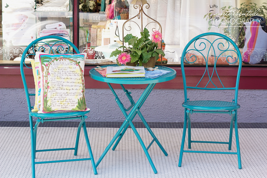 turquoise metal patio table two chairs retail styling astoria oregon