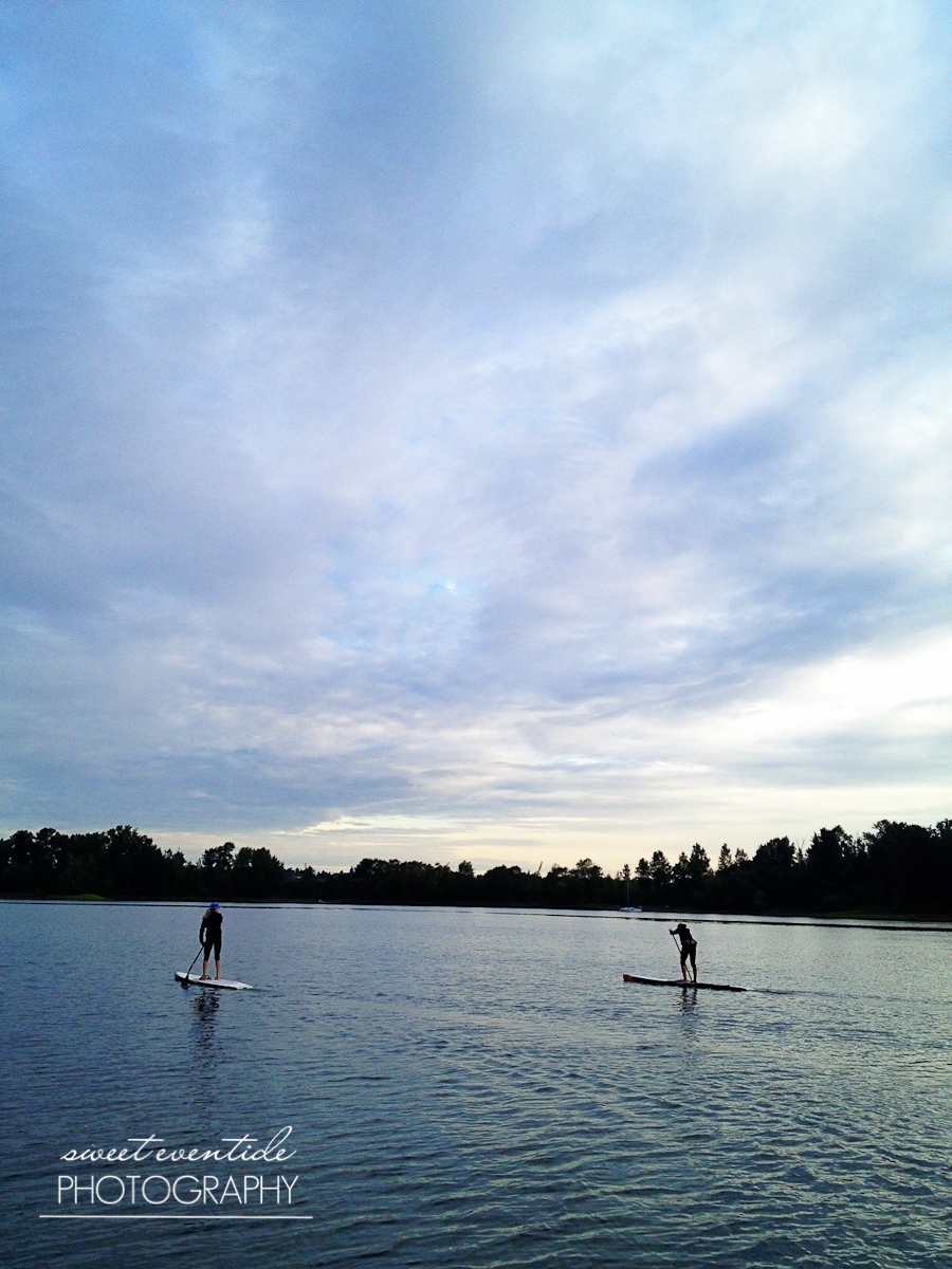 two stand up paddleboarders willamette river portland oregon