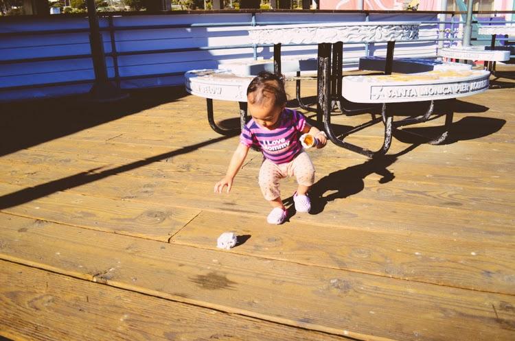 Santa Monica Pier with my baby girl baby eating ice cream