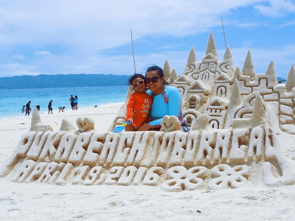 Boracay 2016 Part 2 family white sand beach palm trees blue sky toddler island hopping