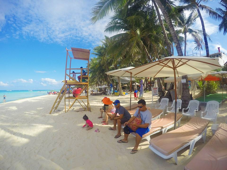 Boracay 2016 Part 2 family white sand beach palm trees blue sky toddler