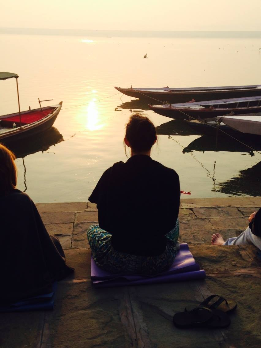 Meditation on the Ganges as the sun rises. Photo Credit: Robin Buck