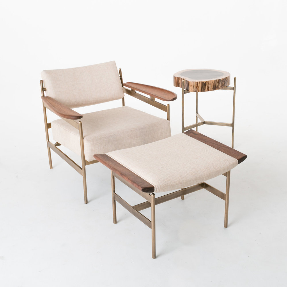 The Boston Chair, Wing Ottoman, and Santos Natural Round