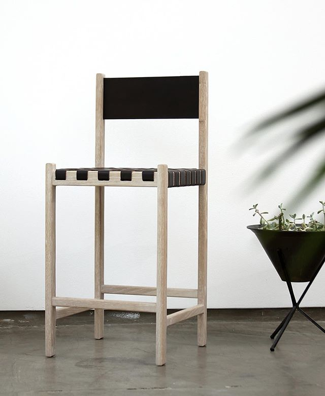 The Leather Strap Stool with black leather and blanched white oak.