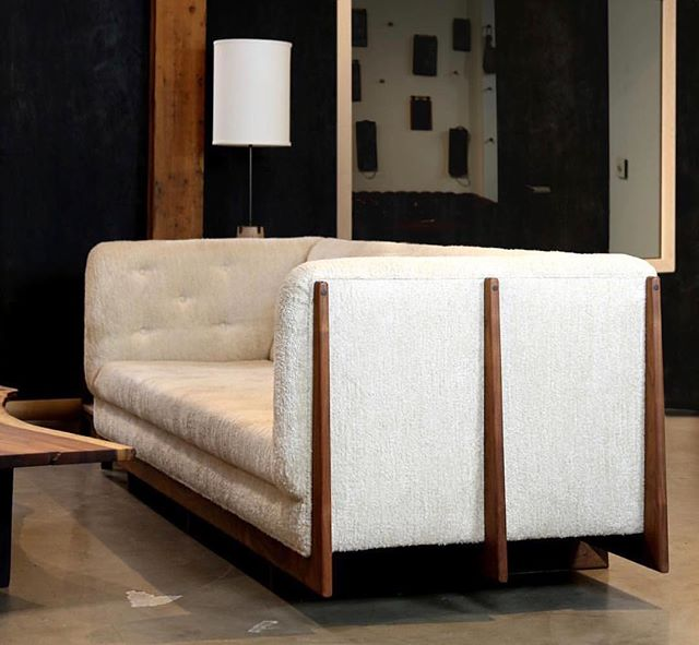 The Hanna Sofa with walnut spines.
